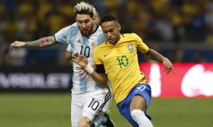 Argentina's Lionel Messi, left, and Brazil's Neymar fight for the ball during a 2018 World Cup qualifying soccer match between Brazil and Argentina at the Estadio Mineirao in Belo Horizonte, Brazil, Thursday Nov. 10, 2016.(AP Photo/Leo Correa)